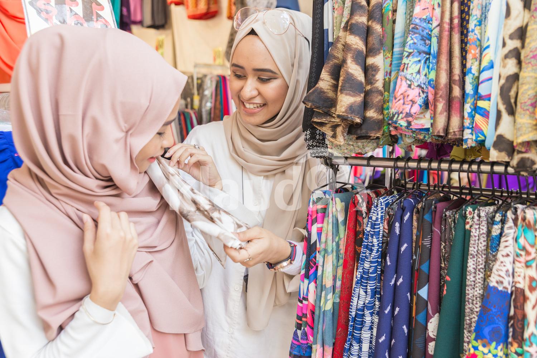 Two muslim women in scarf shop