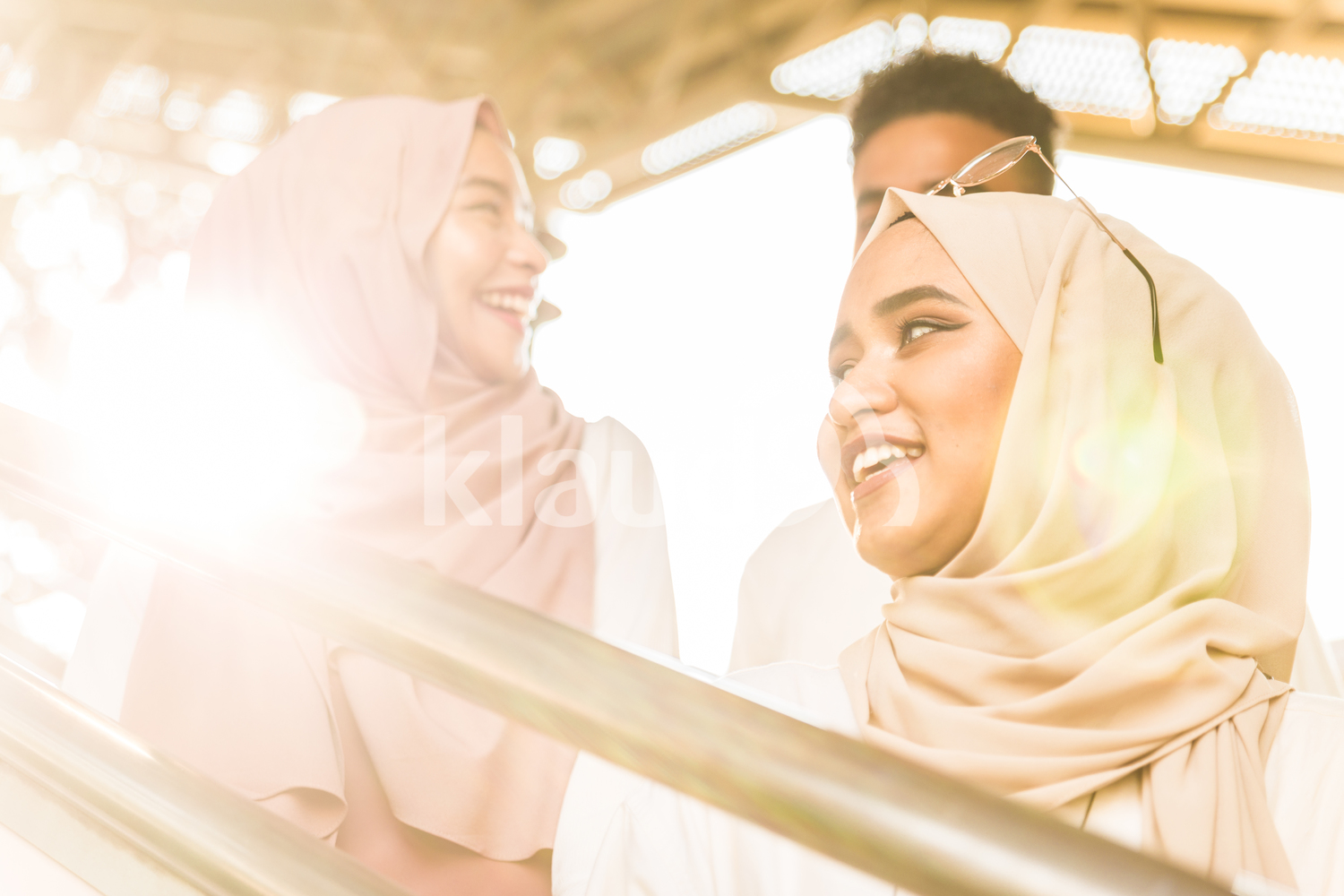 Young muslims smiling
