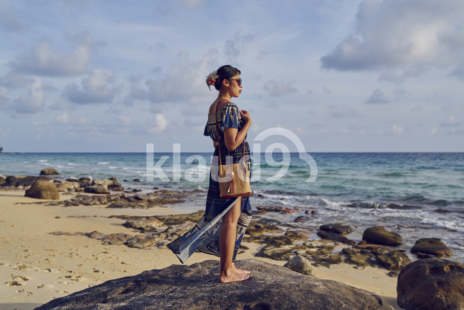 Young woman walking by the beach in Koh Kood, Thailand