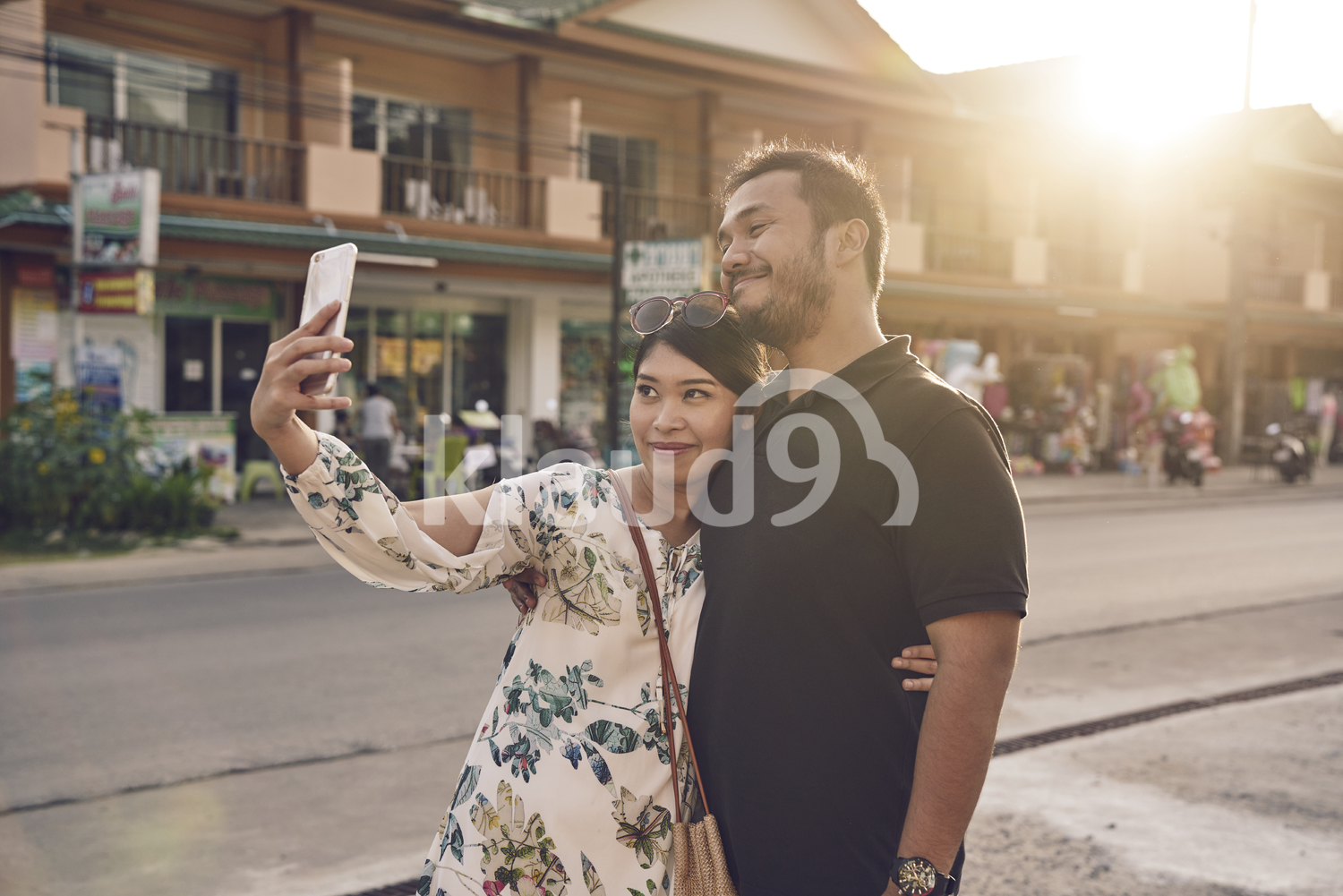 Young couple taking a selfie on the streets of Koh Chang, Thailand