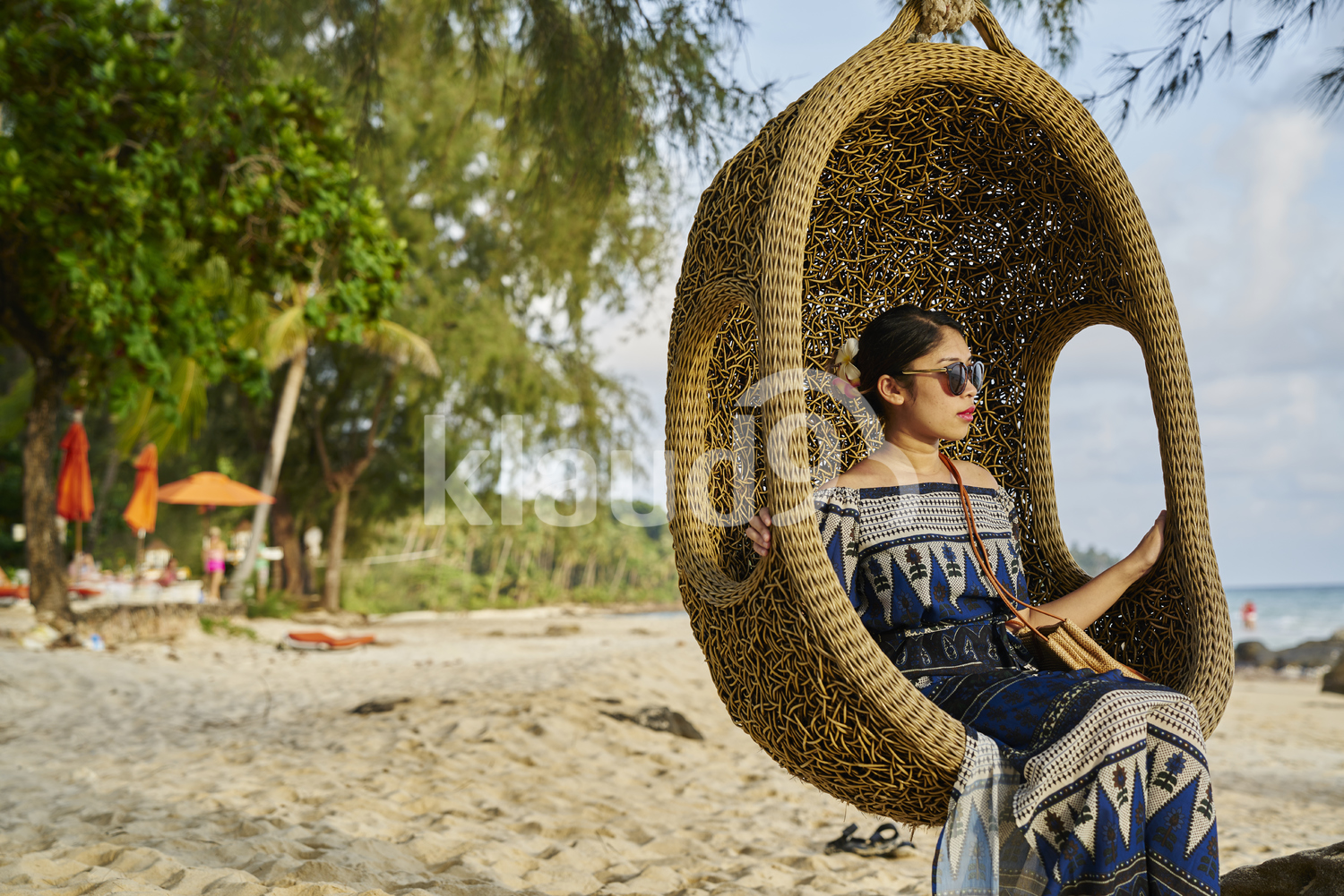 Young woman sitting by the beach in Koh Kood, Thailand