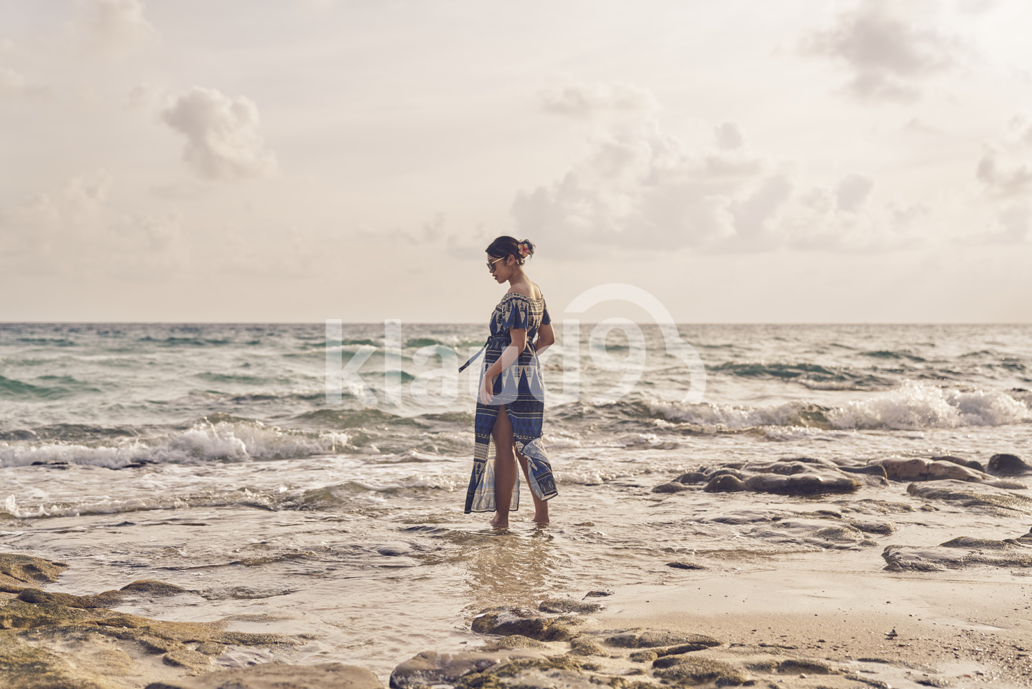 Back view of Young woman walking by the beach in Koh Kood, Thailand