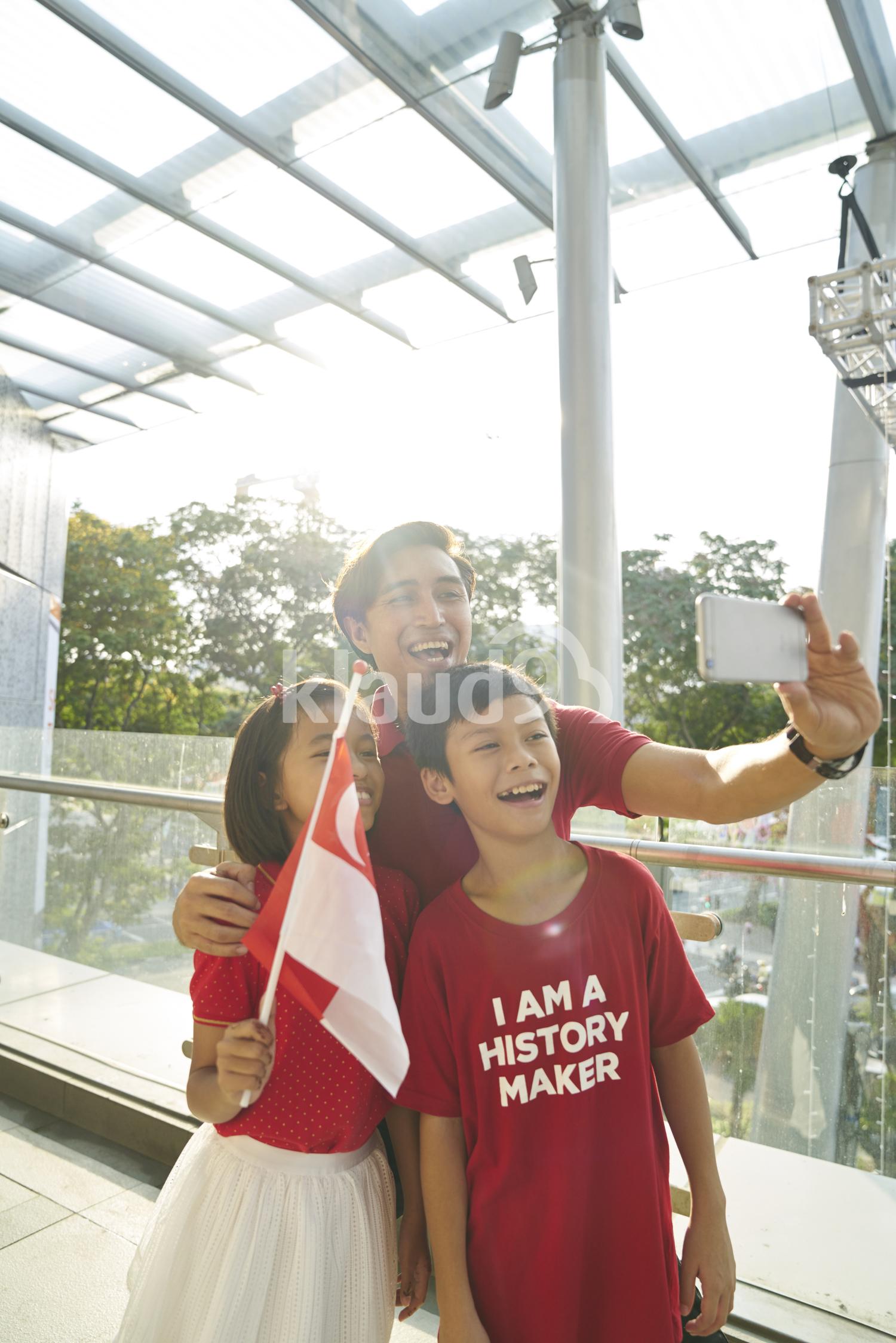 Happy family celebrating Singapore's National Day