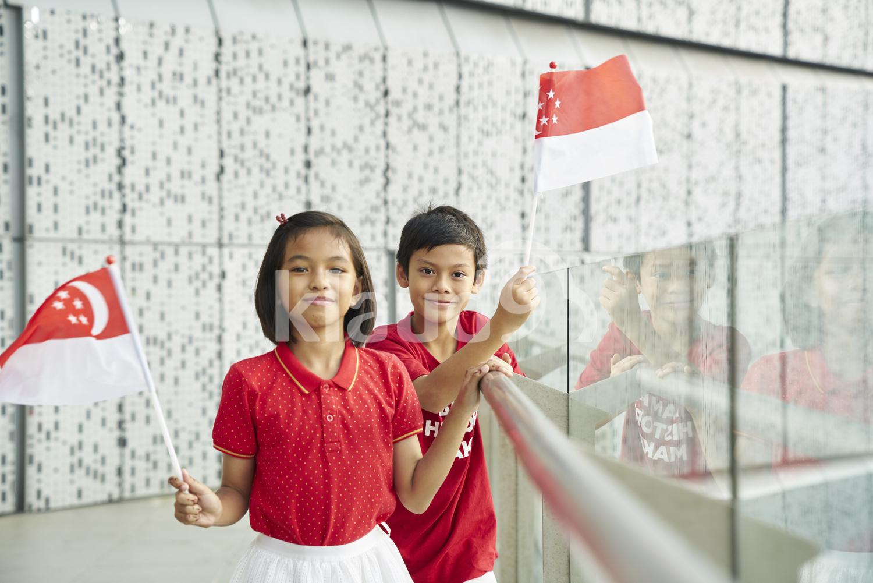 Cute siblings celebrating Singapore's National Day