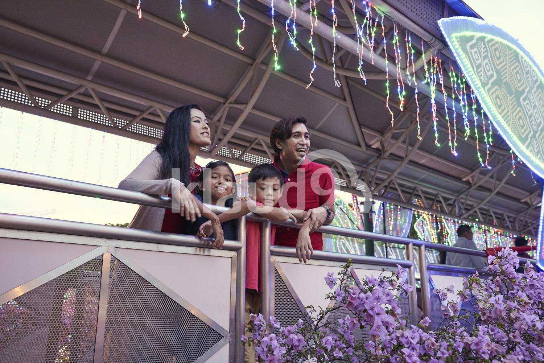Happy family checking out the light up at Geylang Hari Raya Bazaar, Singapore