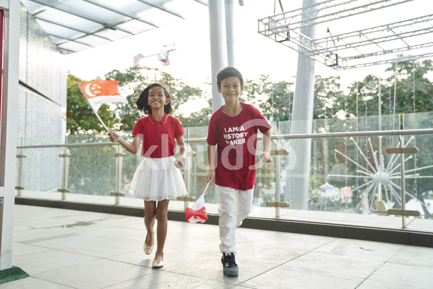 Playful siblings celebrating Singapore's National Day