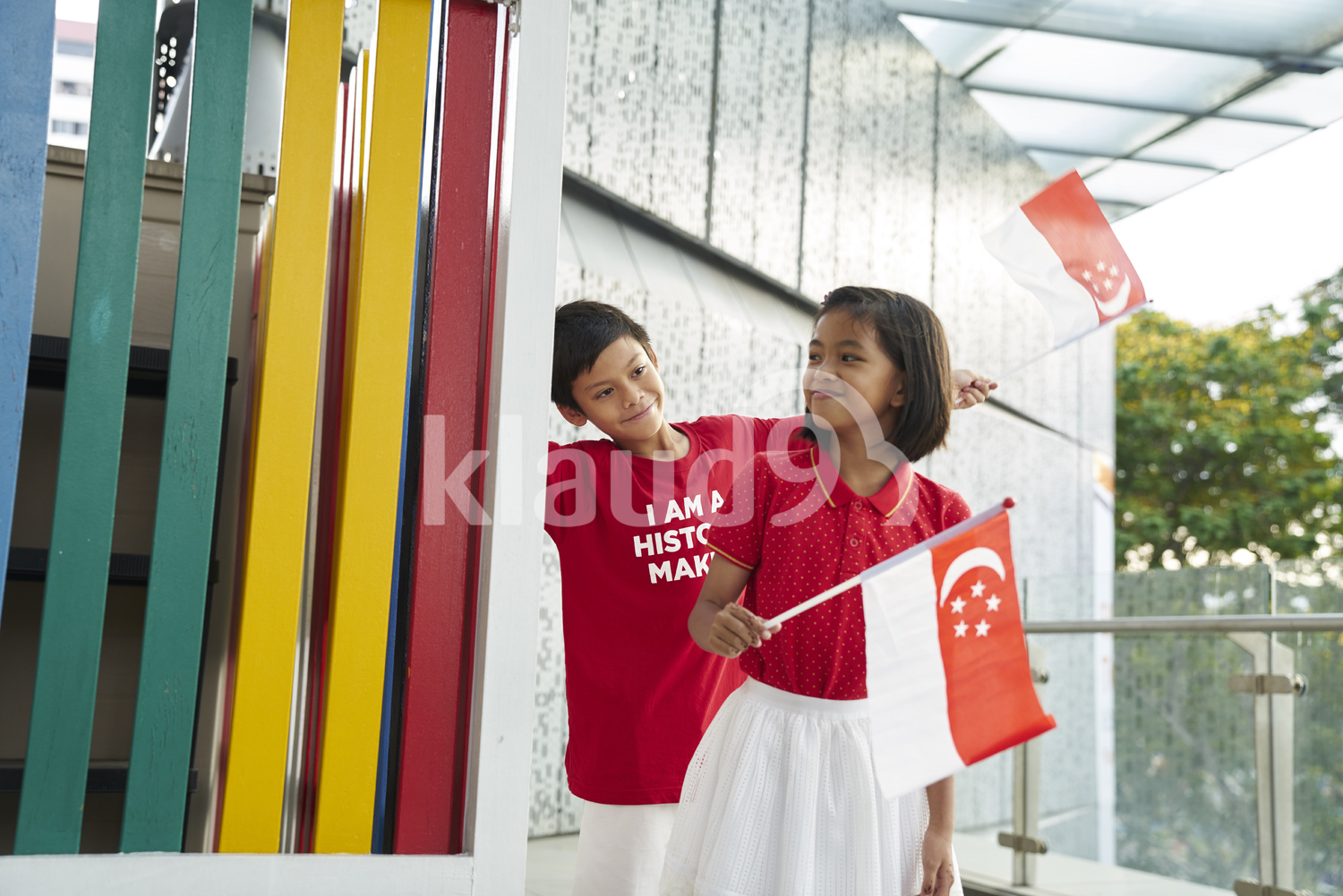 Adorable siblings celebrating Singapore's National Day