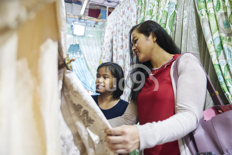 Mother and daughter shopping at Hari Raya bazaar, Singapore
