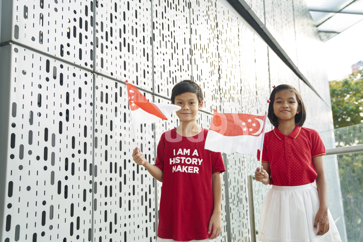 Young siblings celebrating Singapore's National Day