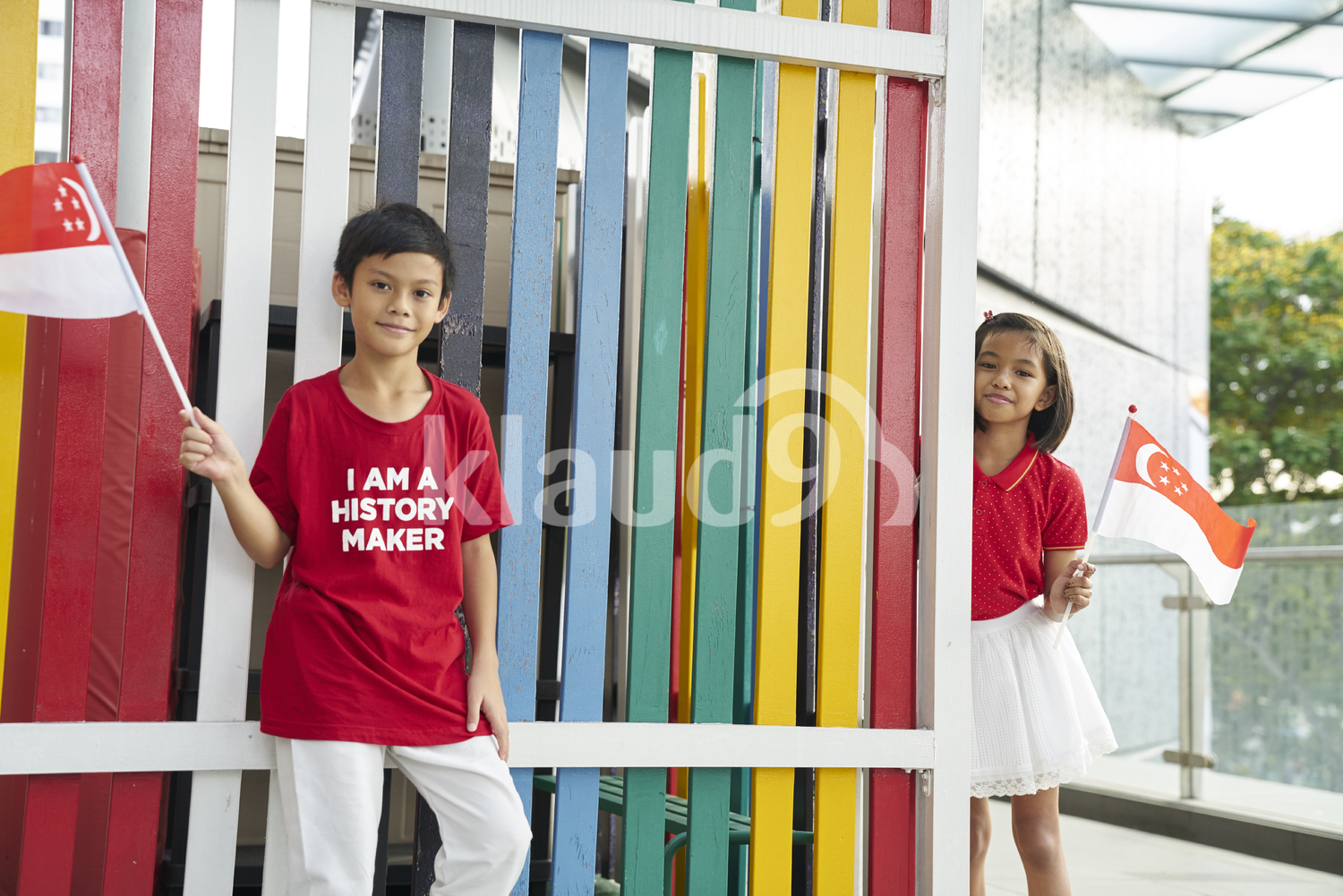 Cheerful siblings celebrating Singapore's National Day