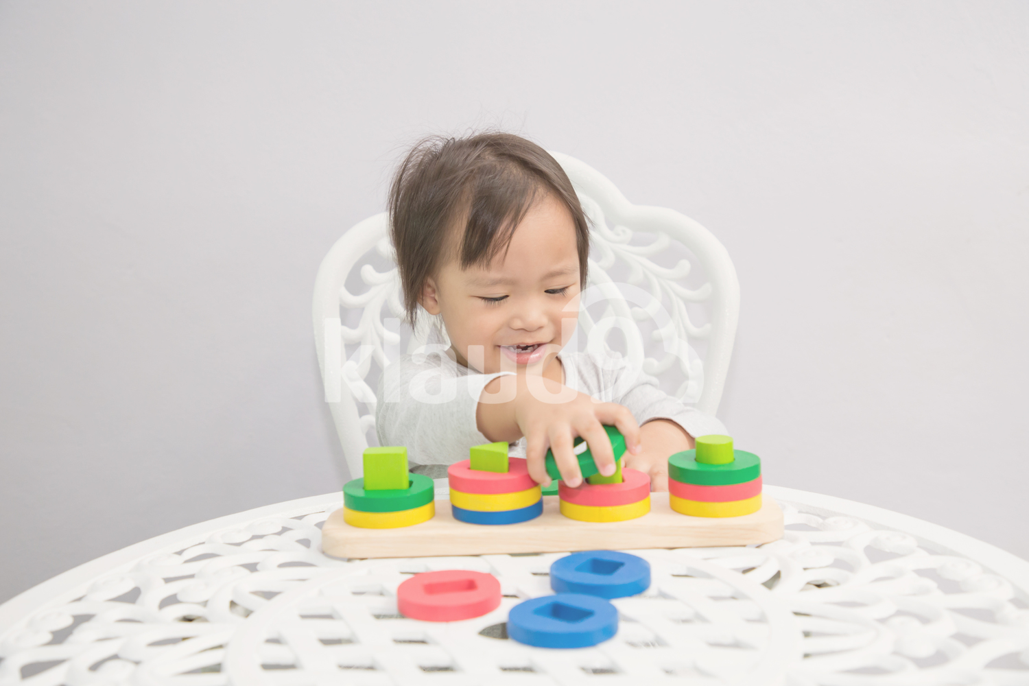 Happy toddler with colorful blocks