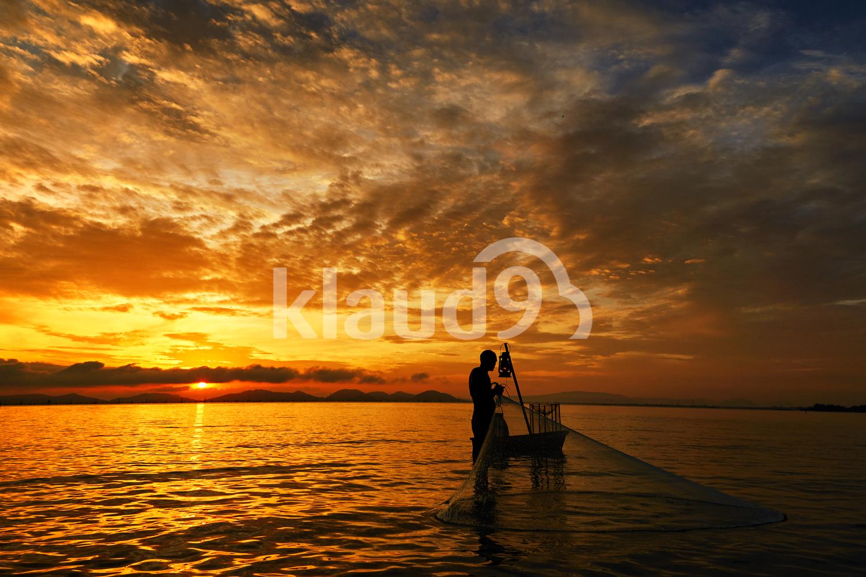 Fisherman fulling his net