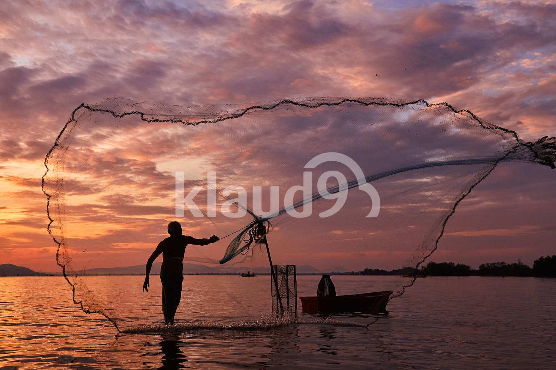 Fisherman throwing his net