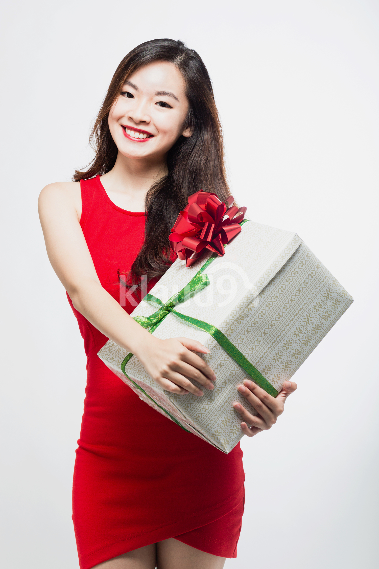 Pan Asian woman with a big gift box