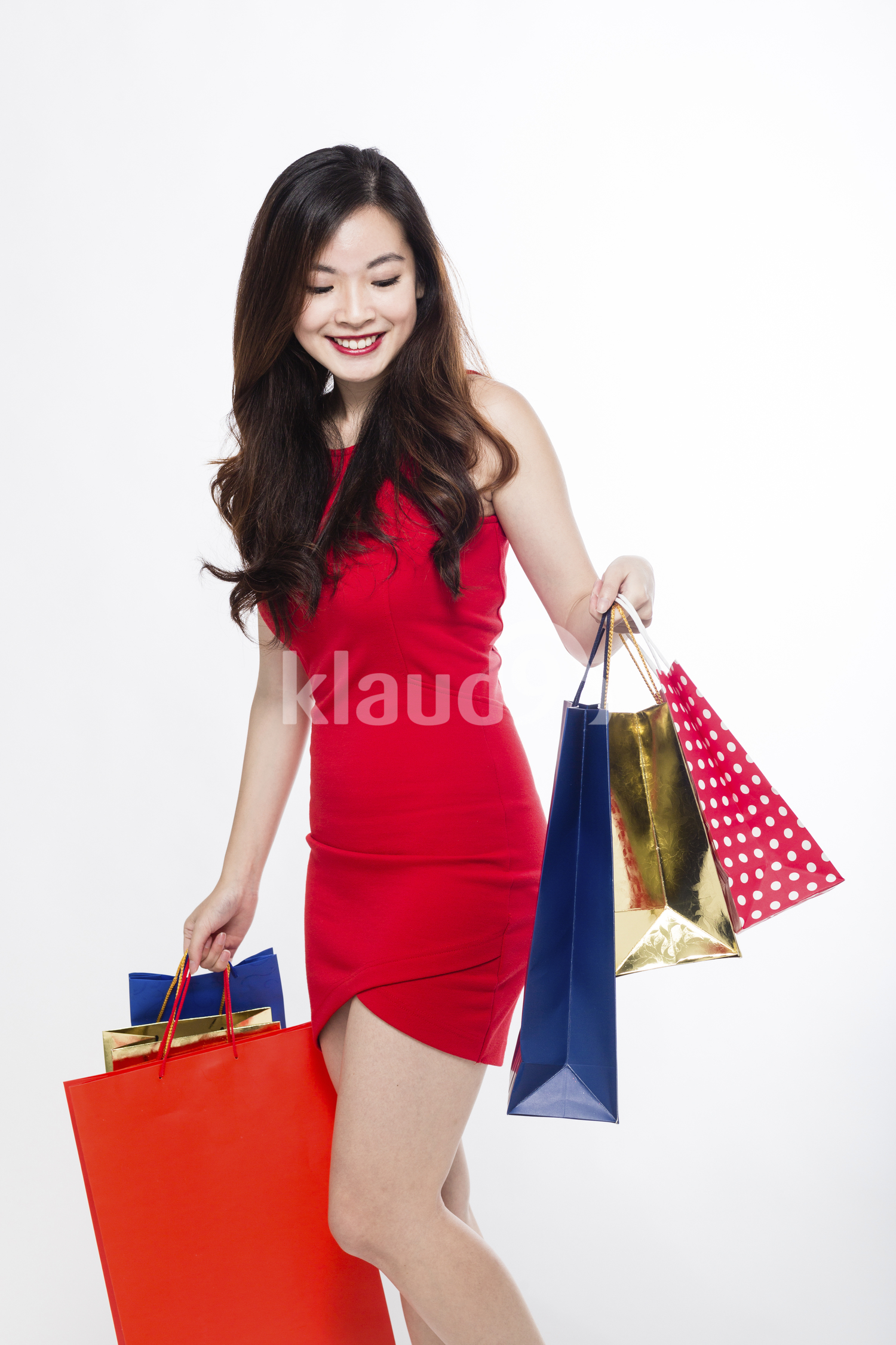 Pan Asian woman with her shopping bags