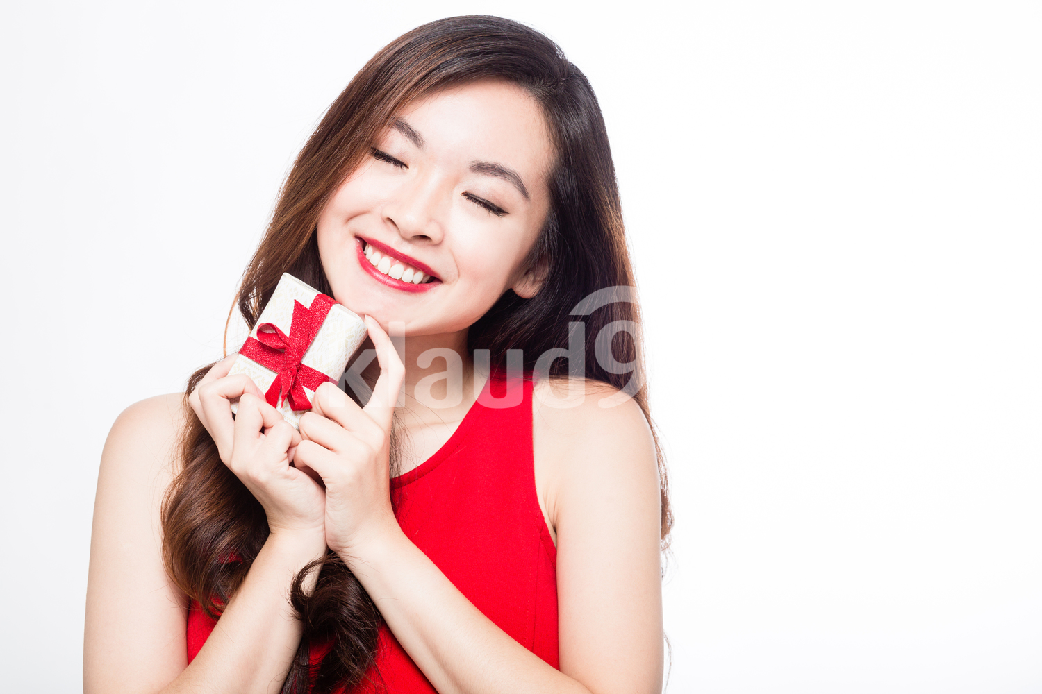 Woman with a gift box with her eyes close