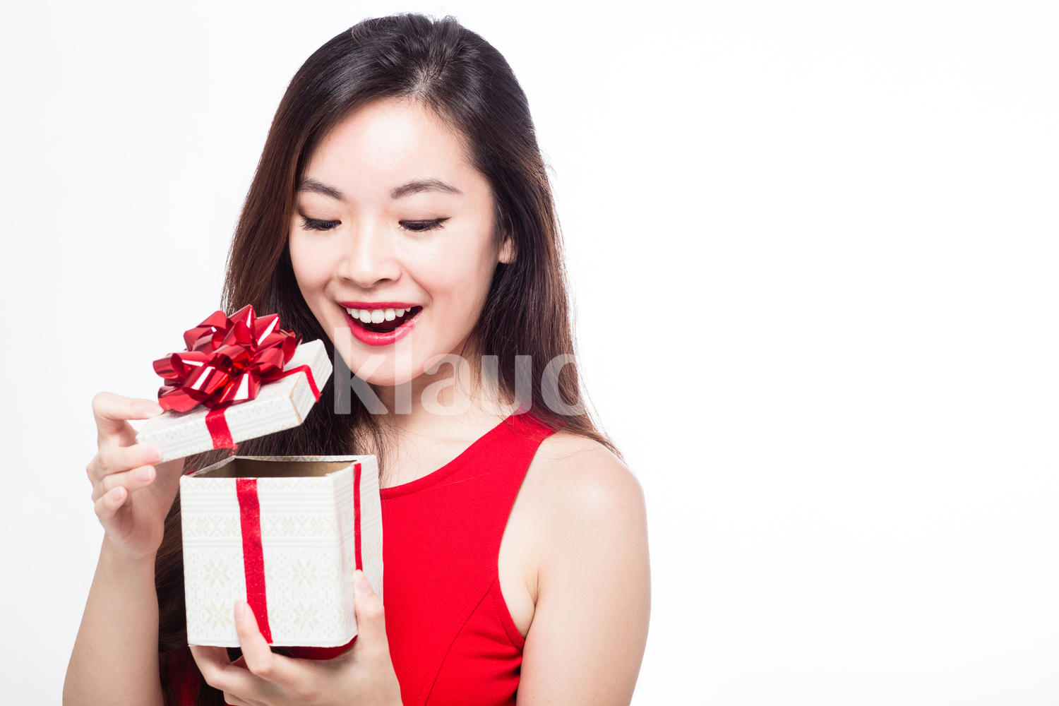Pan Asian woman opening her gift box