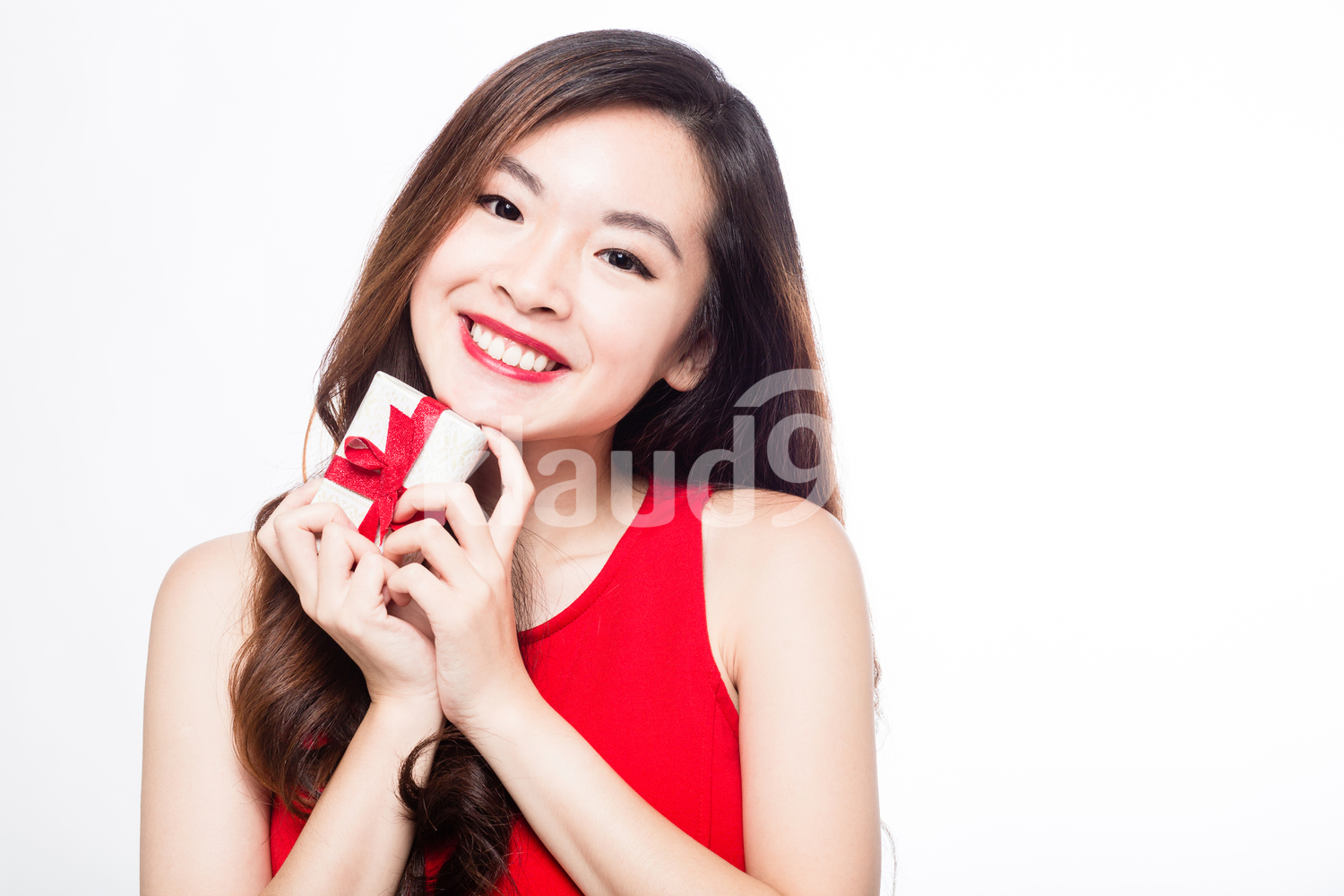 Pan Asian woman with a small gift box