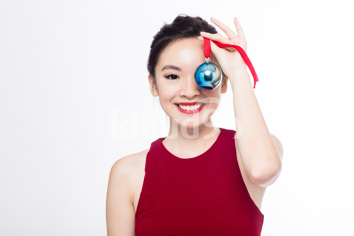 Pan Asian woman with her Christmas ball ornament
