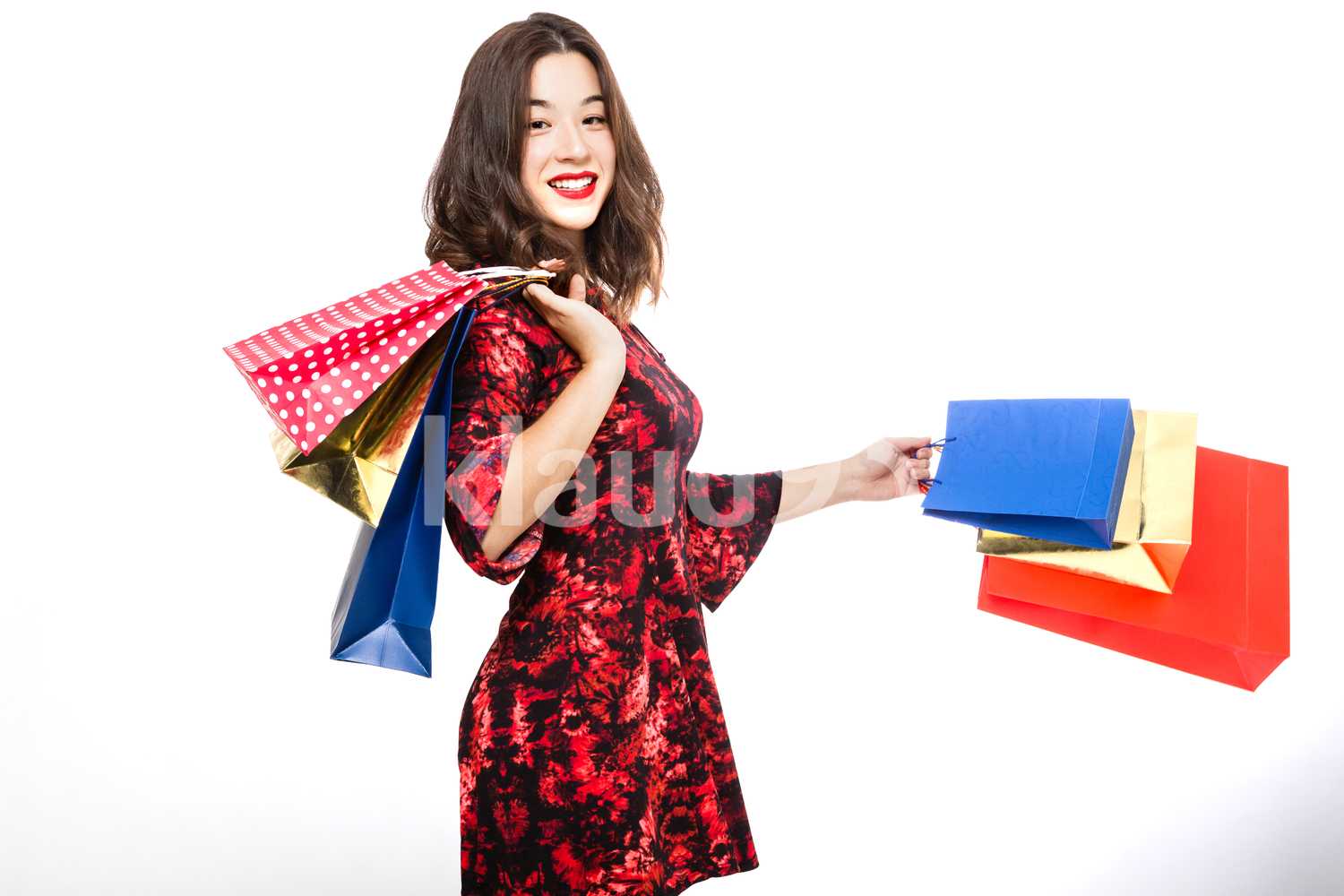Pretty Woman Happily Smiling with her Shopping Bags