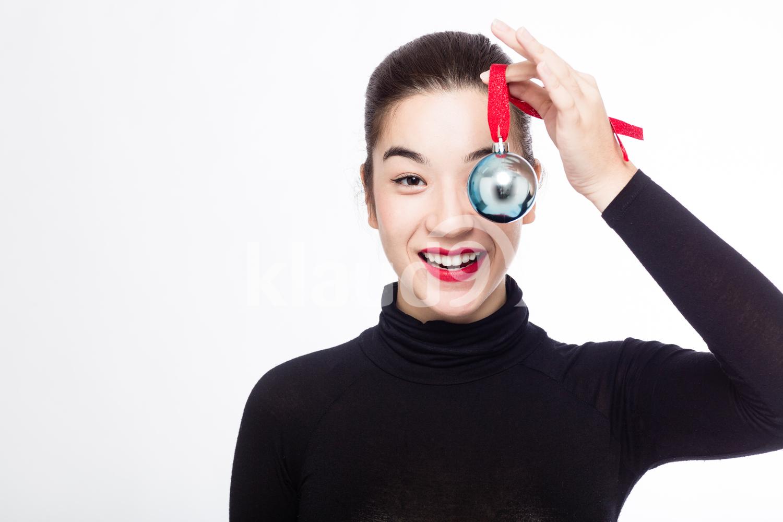 Eurasian Woman with her Christmas Ball Ornament