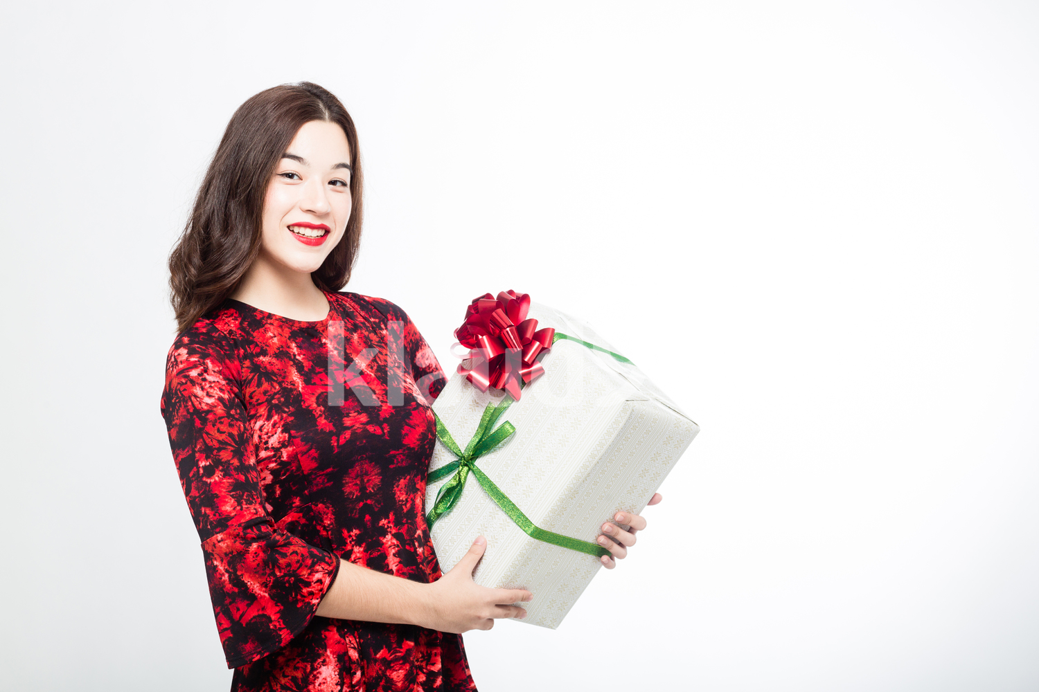 Pretty Woman with a Big Gift Box