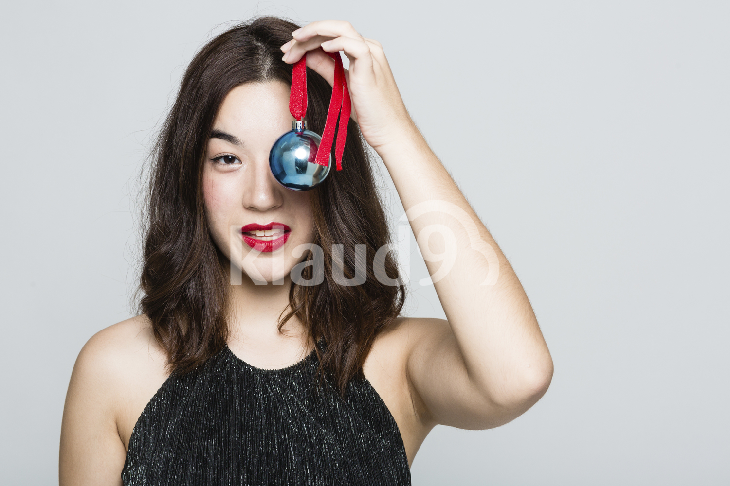 Pretty Woman with a Christmas Ball Ornament