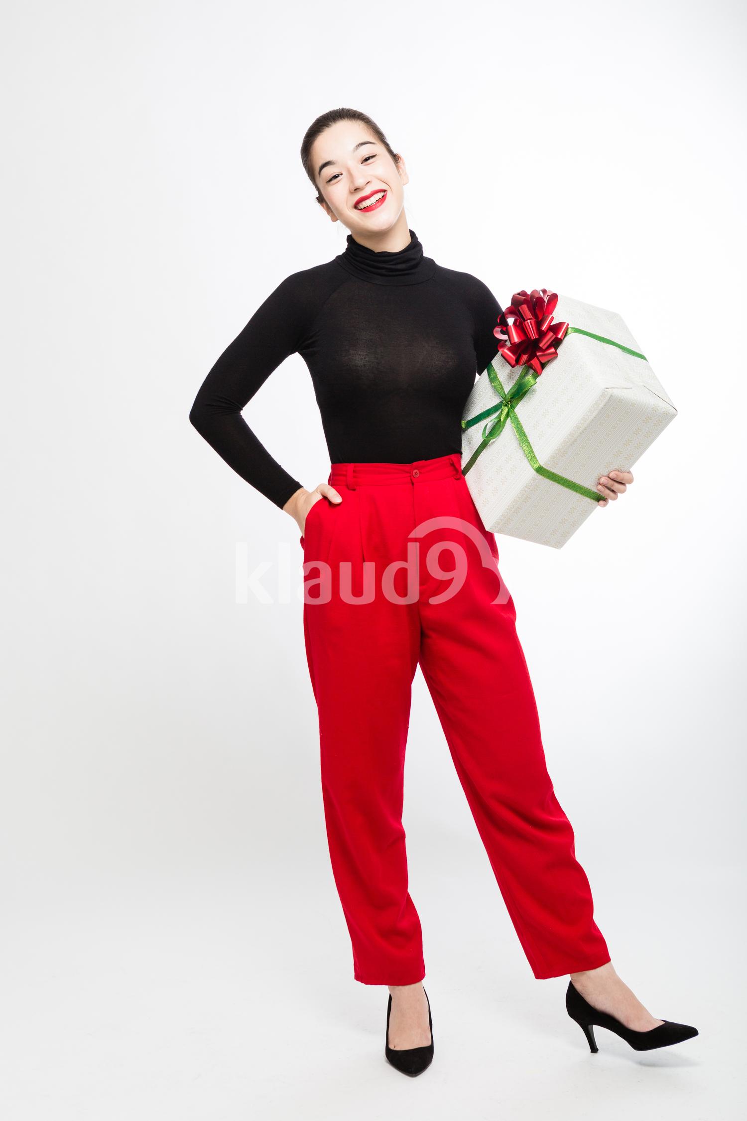 Eurasian Woman with her Big Christmas Gift
