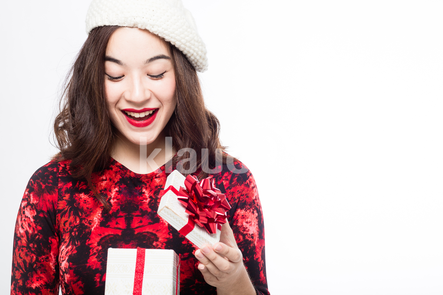 Pretty Eurasian Woman Opening Her Gift Box