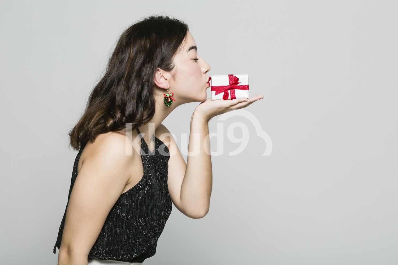 Pretty Woman Kissing a Box