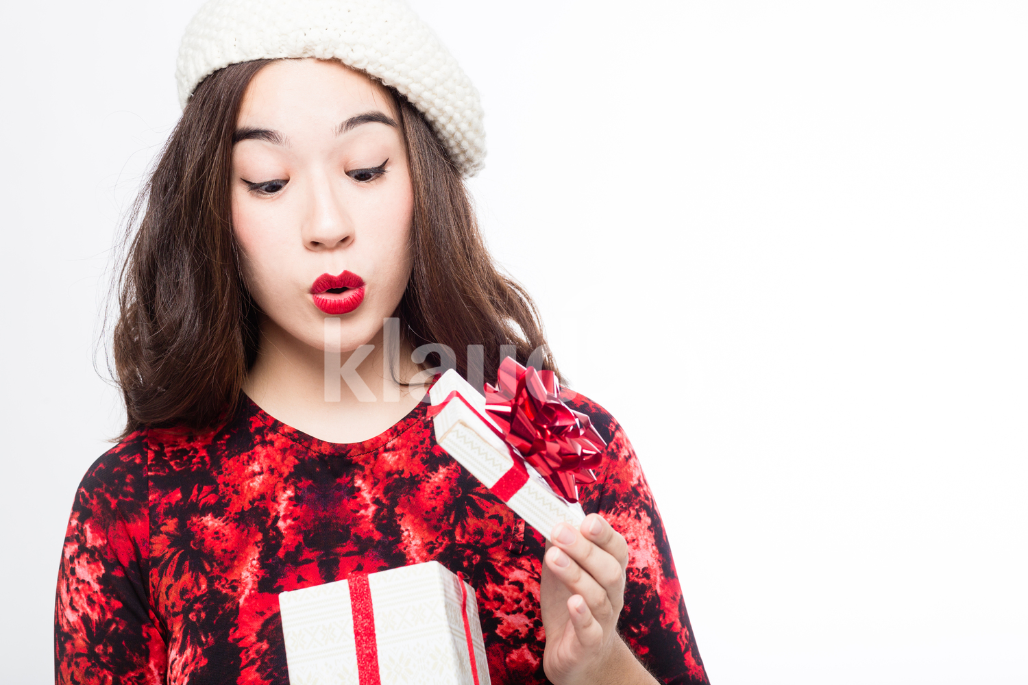 Woman Looking through Her Small Christmas Gift