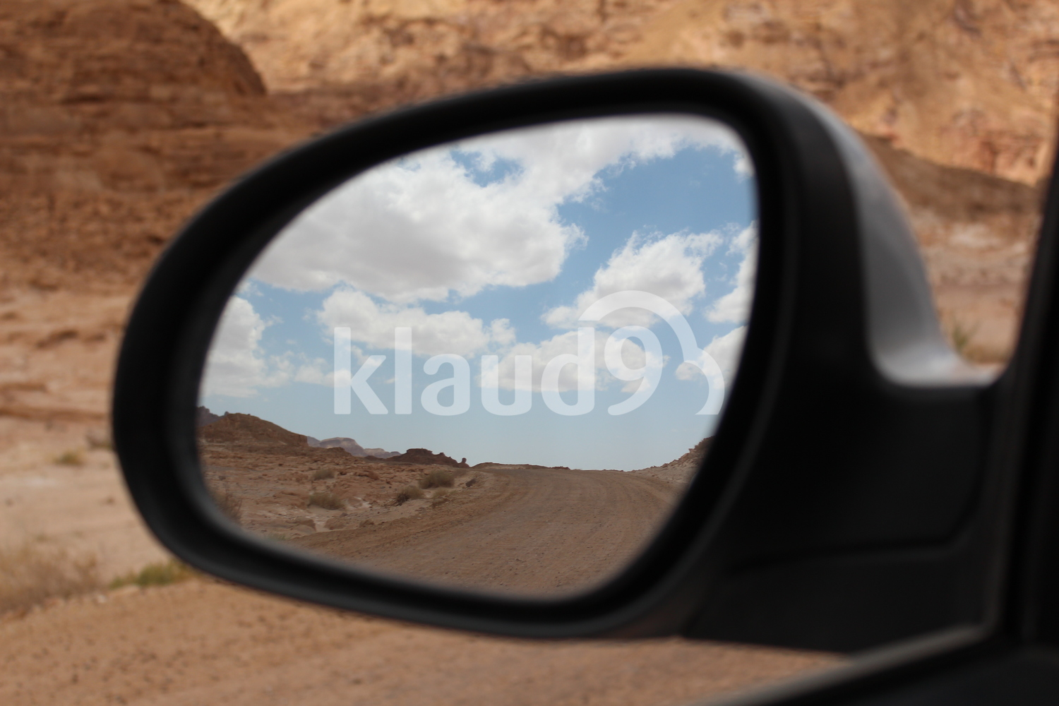 Desert in the car mirror