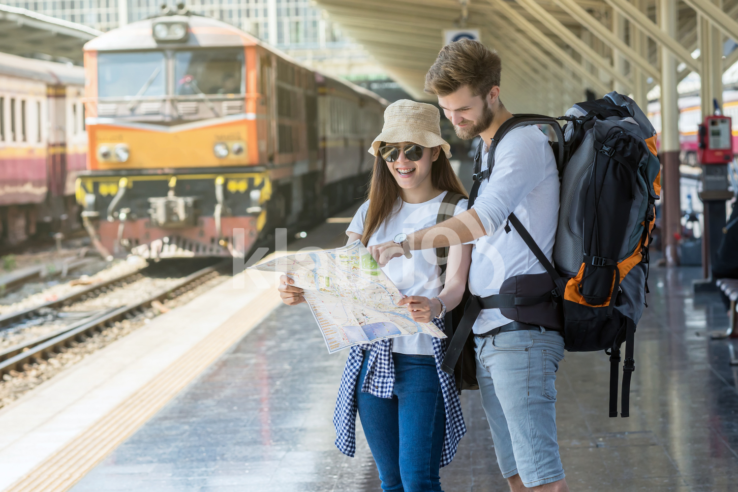 Multiethnic Travellers are looking at the map at the train station, Travel and transportation concept