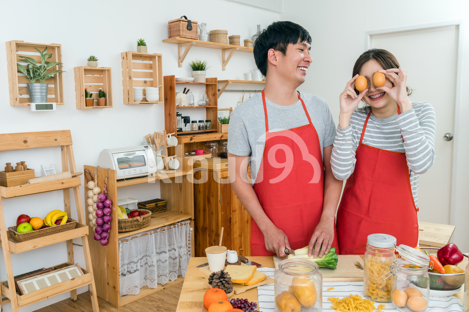 Happy Asian couple having fun in the kitchen