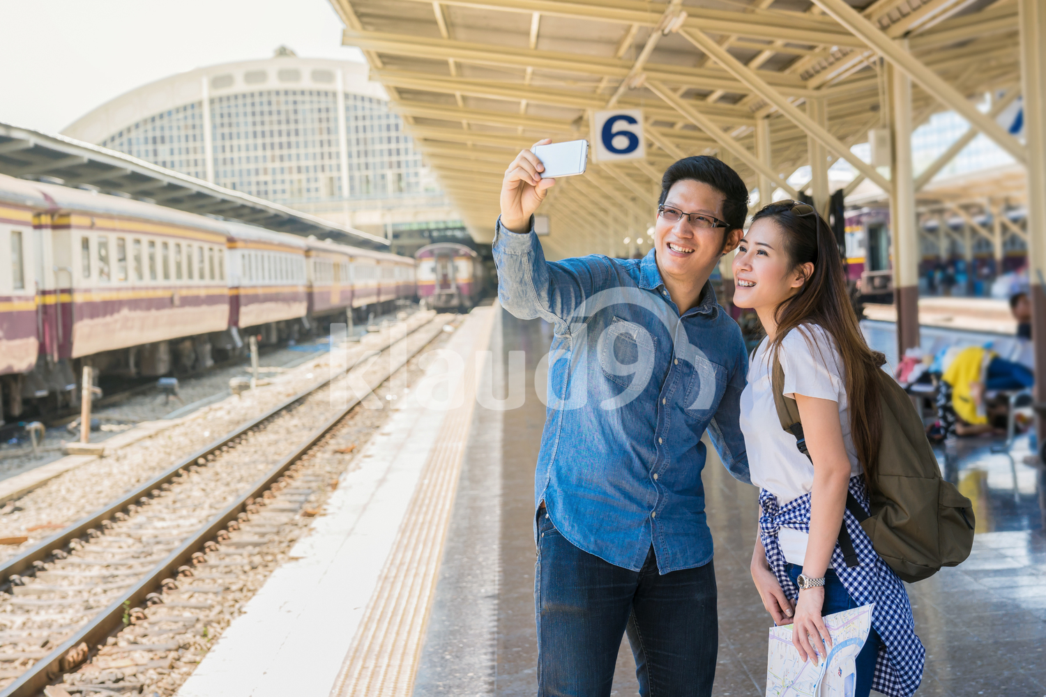 Couple taking selfie photo at the train station