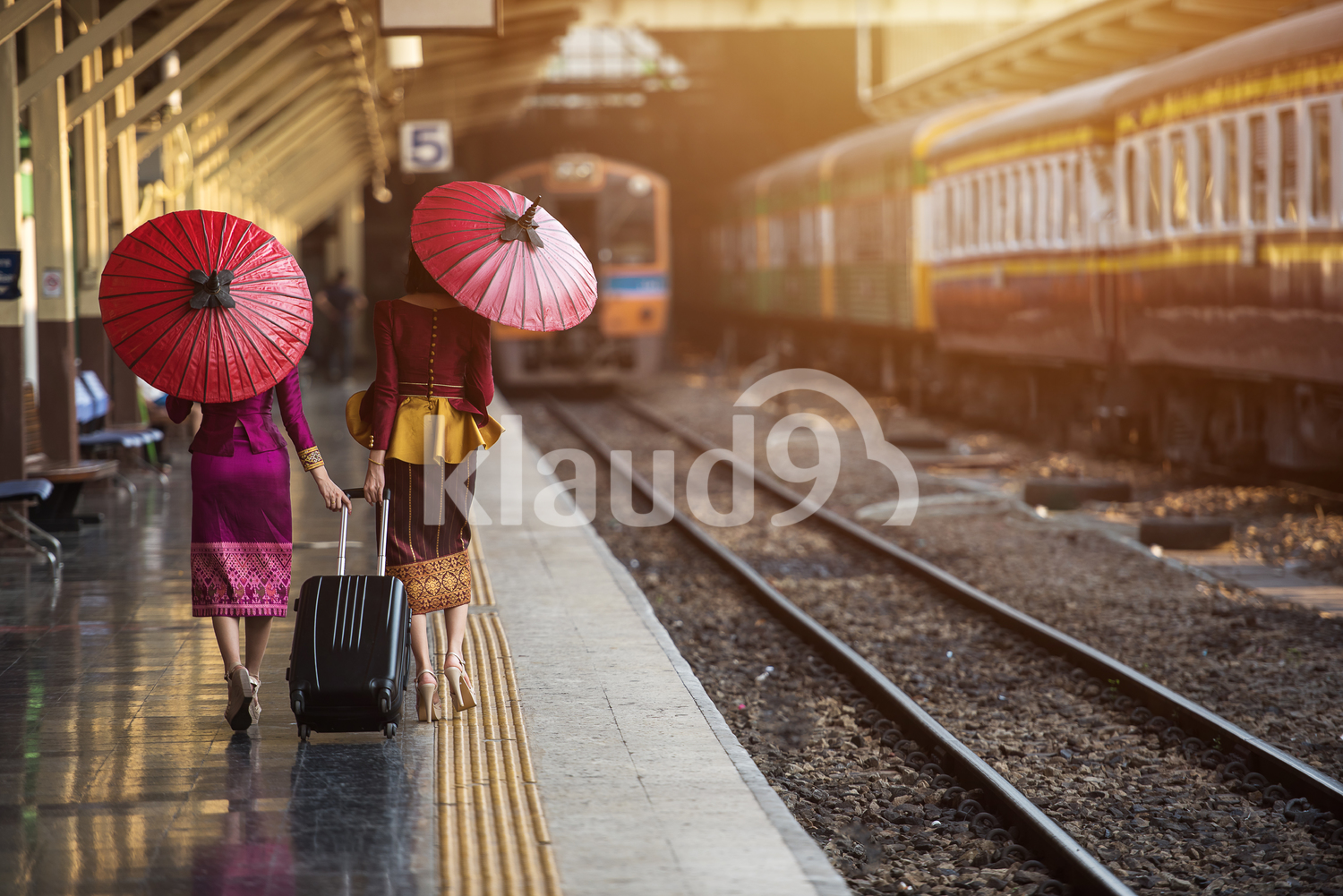 Asian women walking at the train station