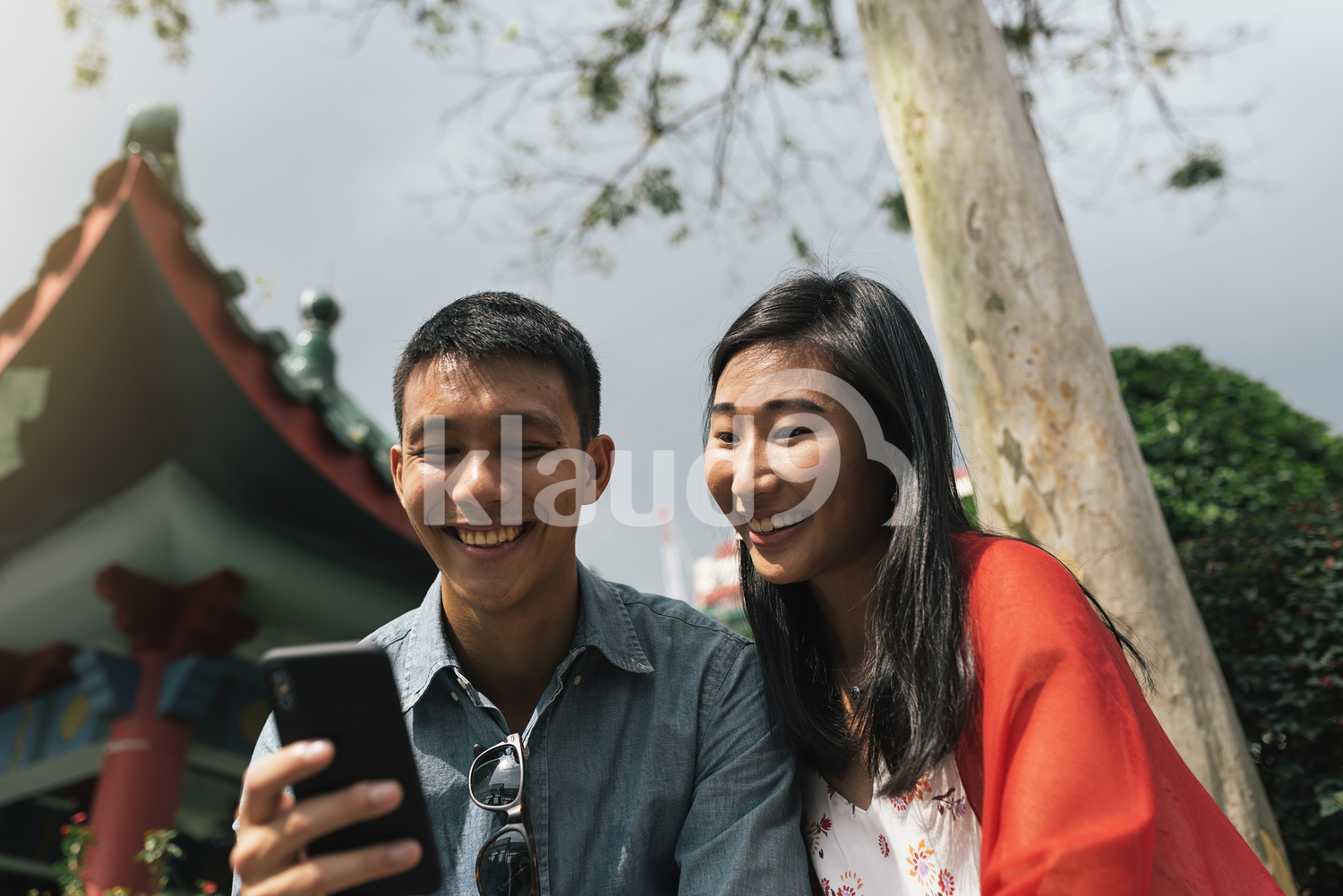 Chinese couple browsing mobile phone