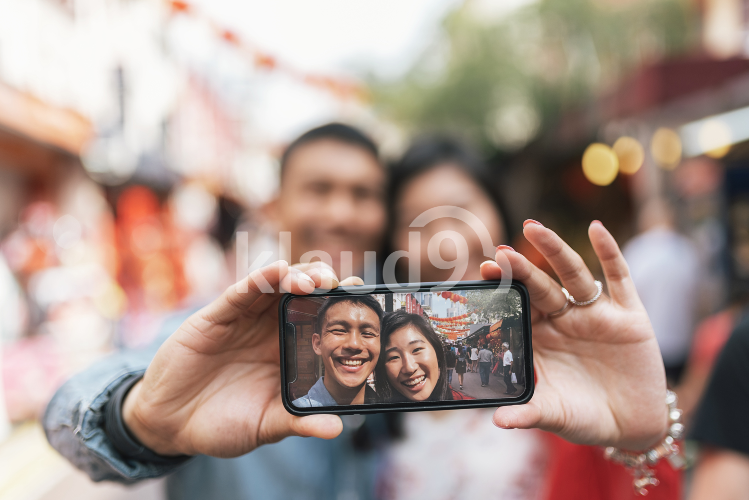 Happy Chinese couple taking selfie
