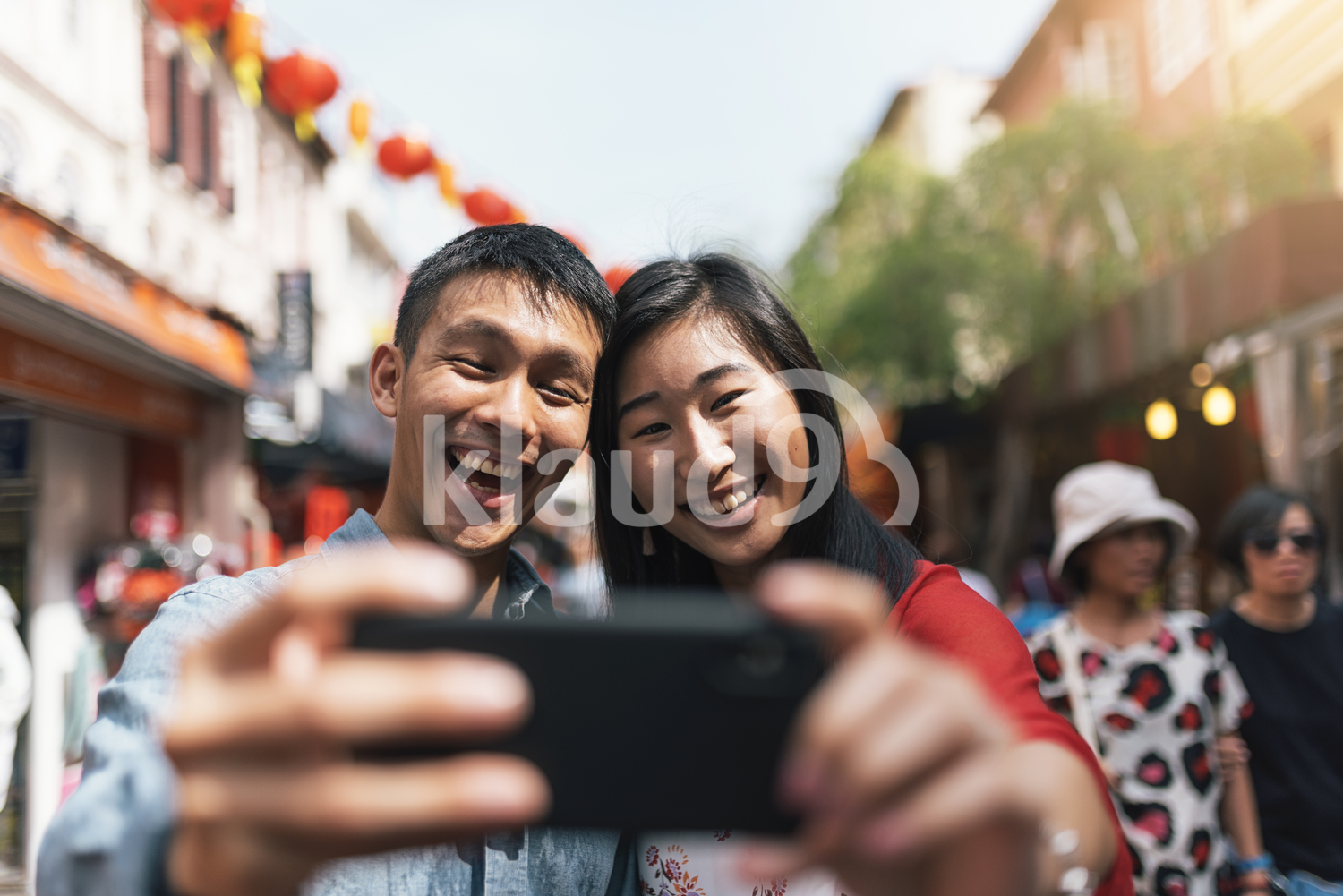 Close up of Chinese couple taking selfie