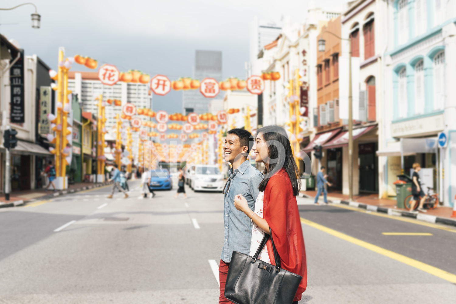 Chinese couple crossing the streets in Chinatown