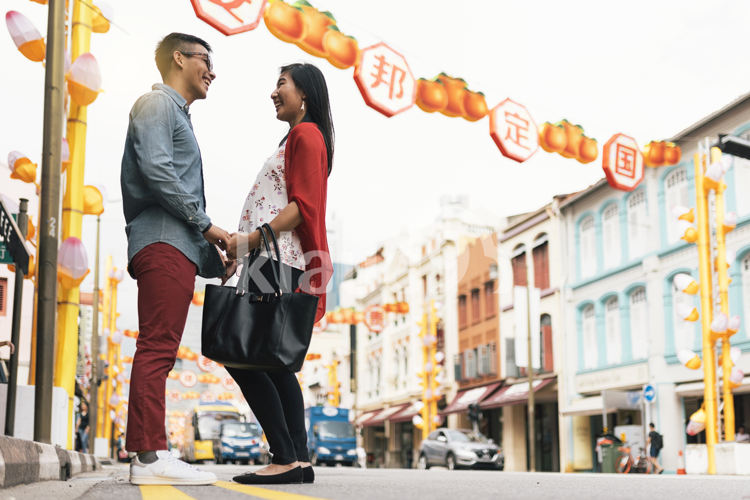 Asian couple on the streets of Chinatown