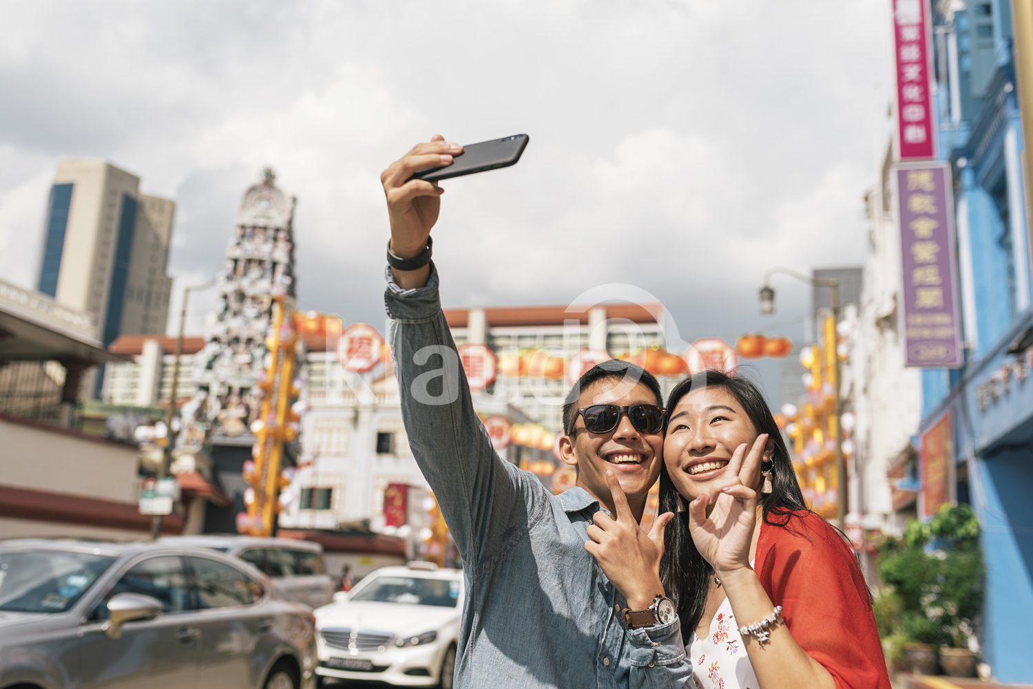 Chinese couple taking couple selfie on the streets