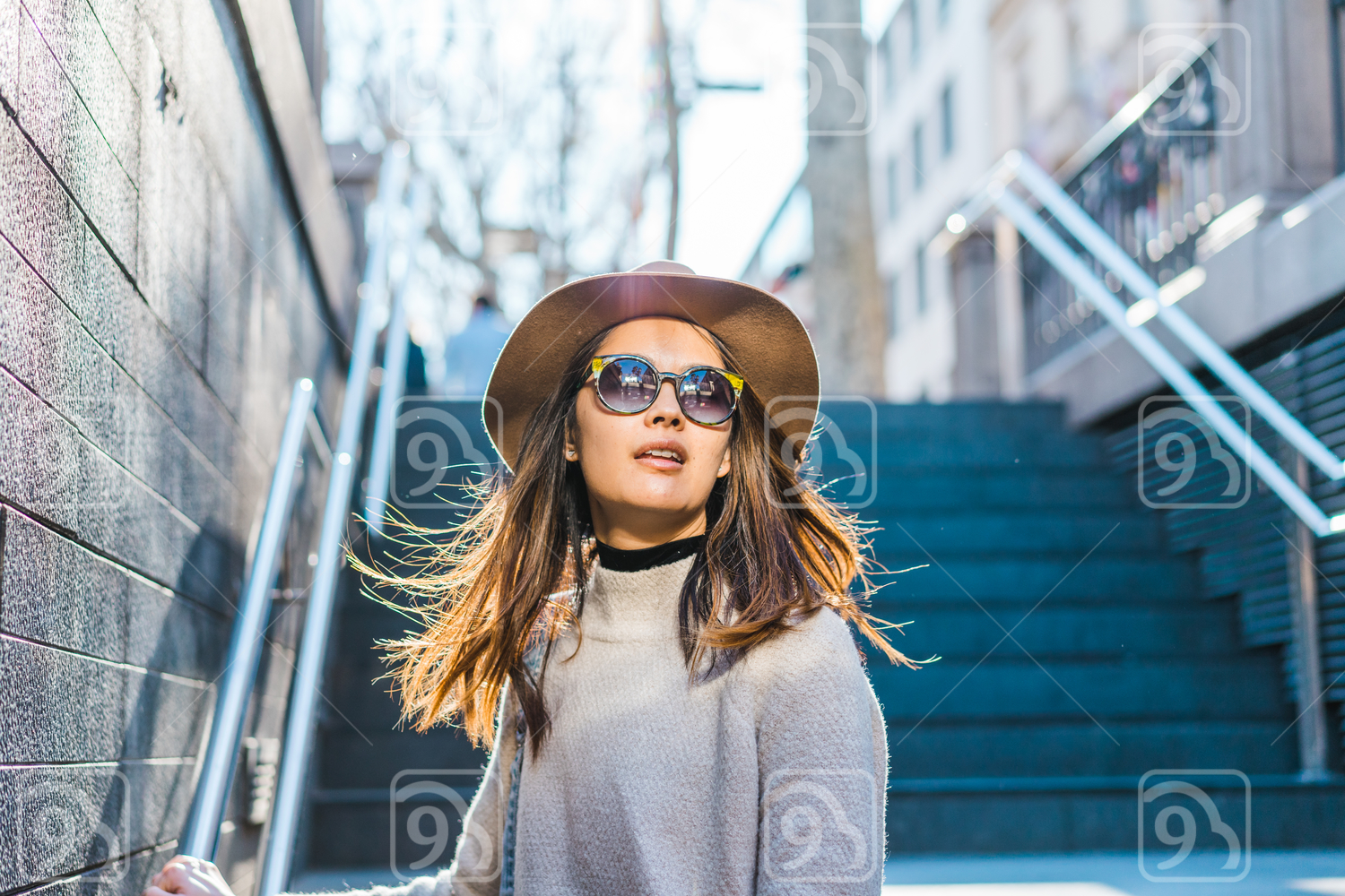 Young Asian woman with sunglasses
