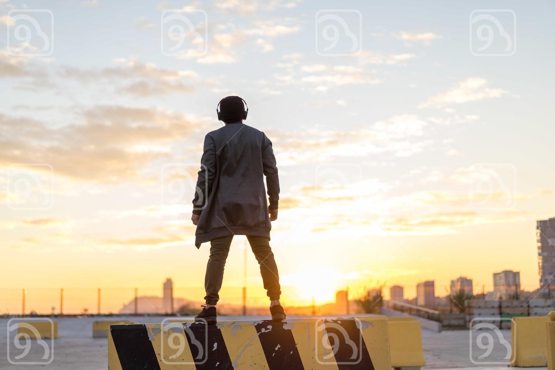 Asian man enjoying the sunset