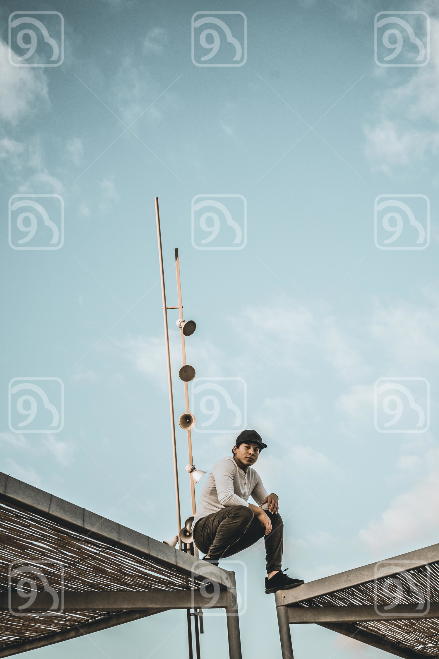 Young man sitting on rooftop