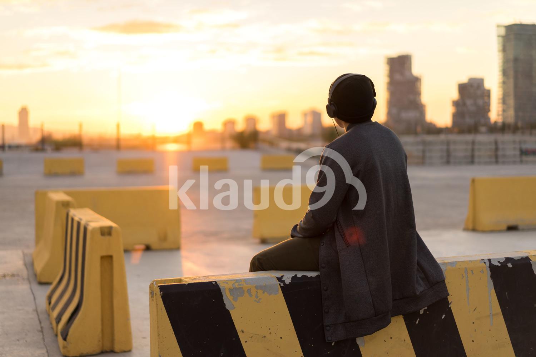 Asian man sitting enjoying the sunset
