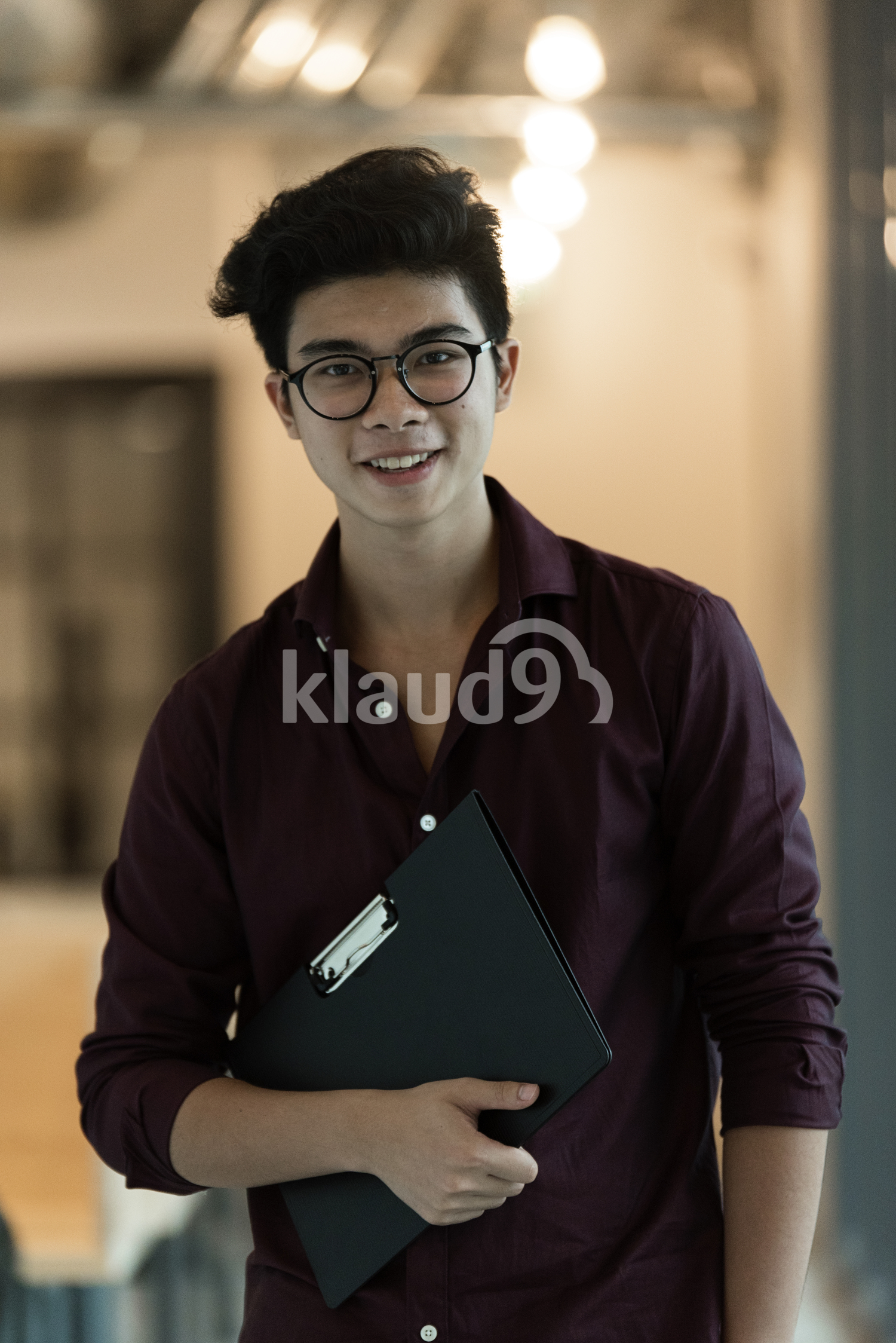 Chinese Business man holding a black file