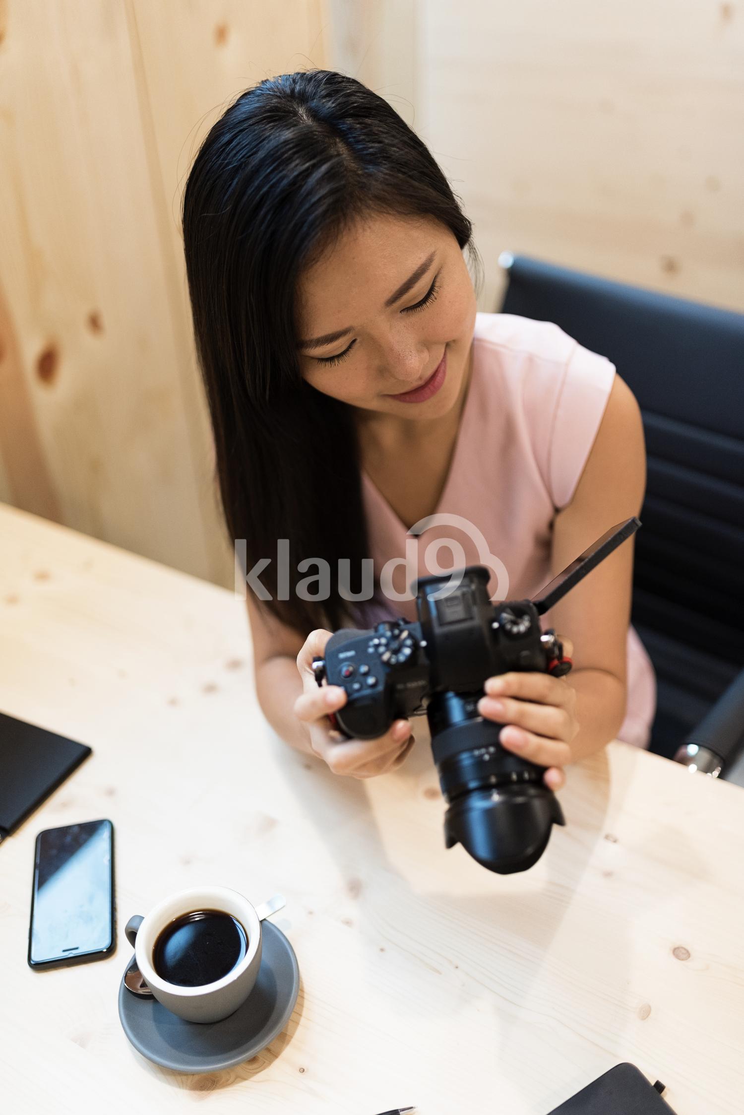 Asian woman looking at the Camera