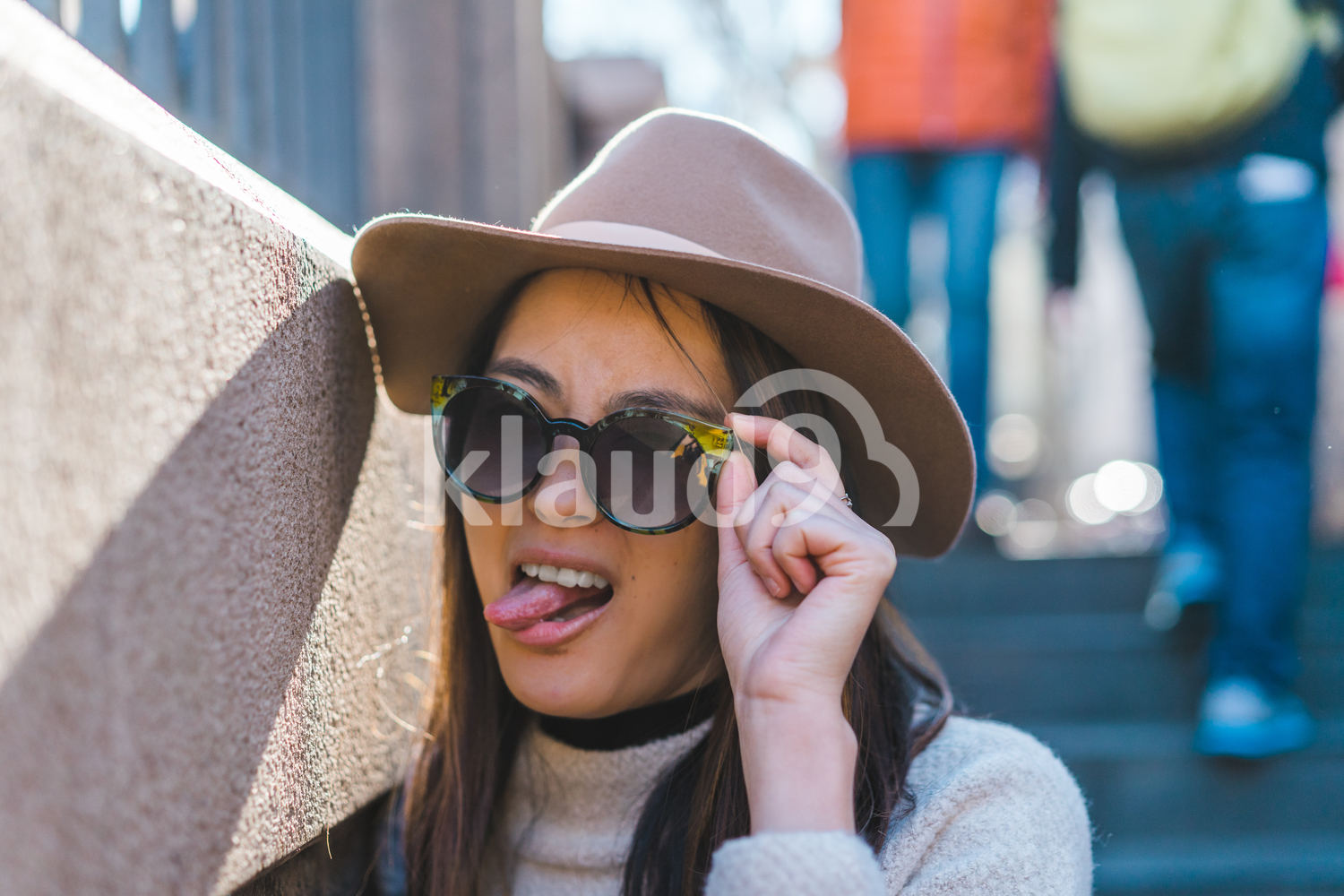 Portrait of young Asian woman poking tongue out