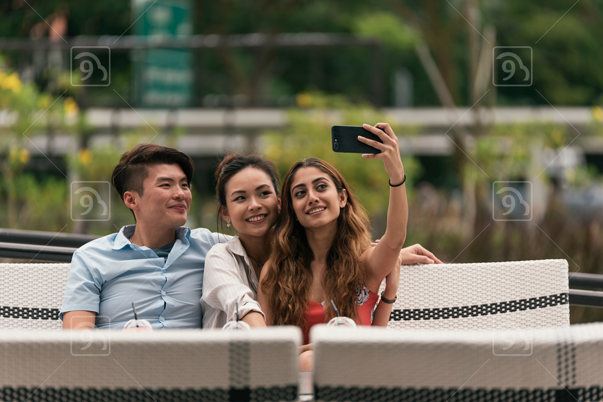 Group of friends taking wefie with cameraphone